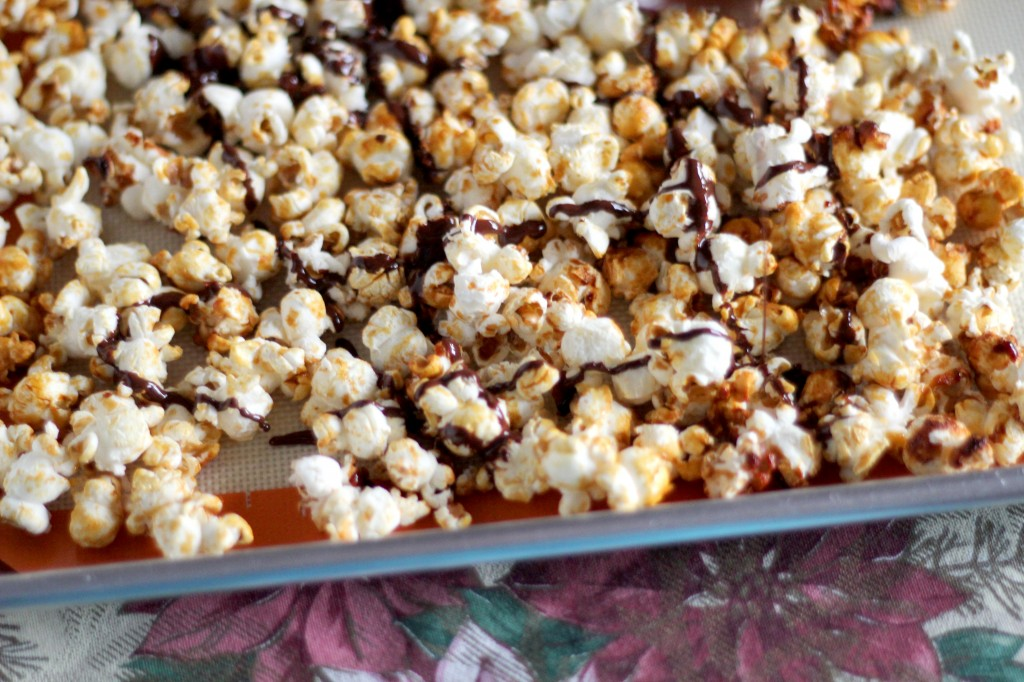 Dark chocolate drizzled popcorn | gatherforbread.com