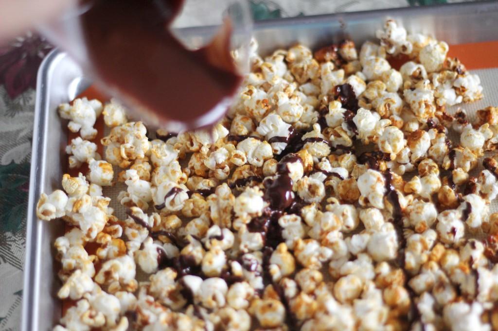 Dark chocolate drizzled popcorn | gatherforbread.com