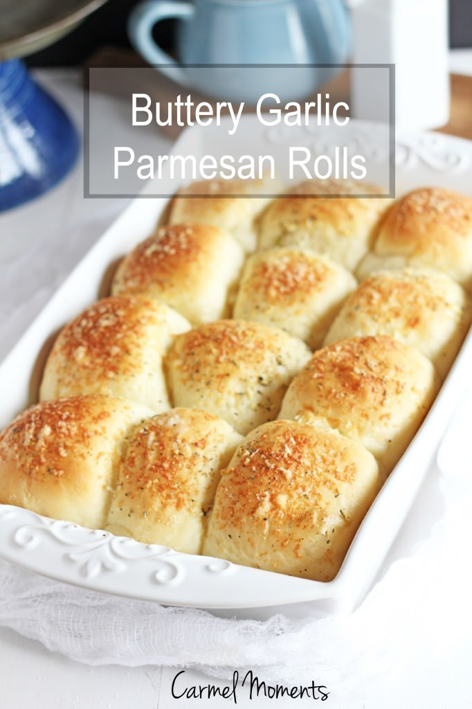 Buttery Parmesan Garlic Rolls -- Simple fluffy rolls topped with butter and Parmsesan and a hint of garlic. | gatherforbread.com