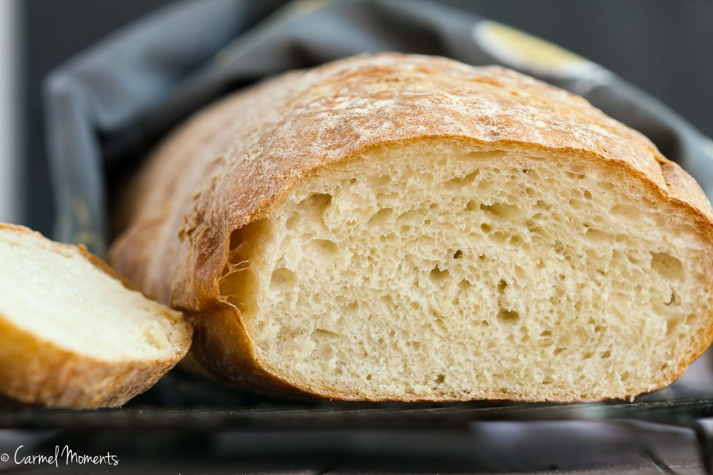 Rustic Italian Bread - This crusty Italian bread loaf makes the perfect addition to the dinner table. A great side for pasta, soup and Sunday dinner.