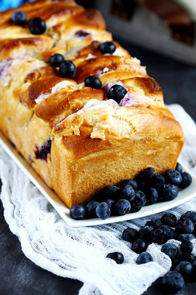 Blueberry Cream Cheese Pull Apart Bread - Delicious homemade pull apart bread is made with homemade dough, stuffed with cream cheese and studded with fresh blueberries. A summer favorite for berry lovers!