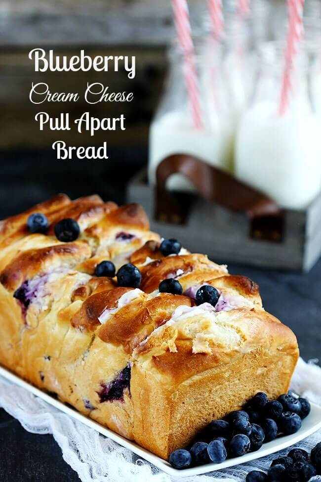 Delicious homemade pull apart bread is made with homemade dough, stuffed with cream cheese and studded with fresh blueberries. A summer favorite for berry lovers!