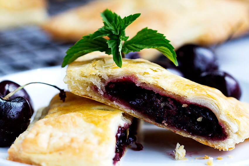 Sweet Cherry Hand Pies - Handheld cherry pies made with sweet fresh cherries. All whole ingredients, made with real dough, make a perfect summer dessert that's easy to share and great for hands.