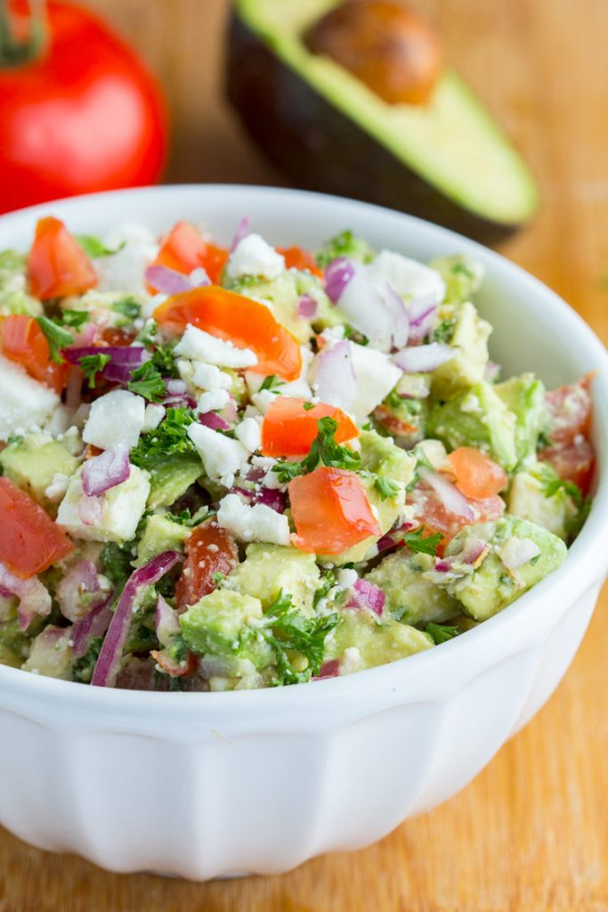 Avocado Feta Dip - Delicious addicting 'crack' dip made with feta cheese, fresh tomatoes, avocado chunks, vinaigrette, and herbs. Can't get enough of this healthy fresh blend. Perfect party appetizer.