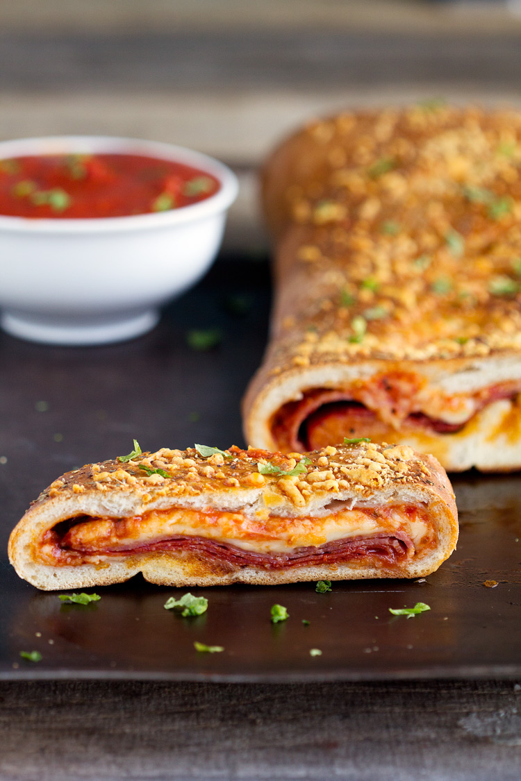 How to Make Stromboli - Recipe for how to make homemade stromboli made with pizza dough. Real dough, stuffed pepperoni salami and cheeses for an authentic Italian dinner.