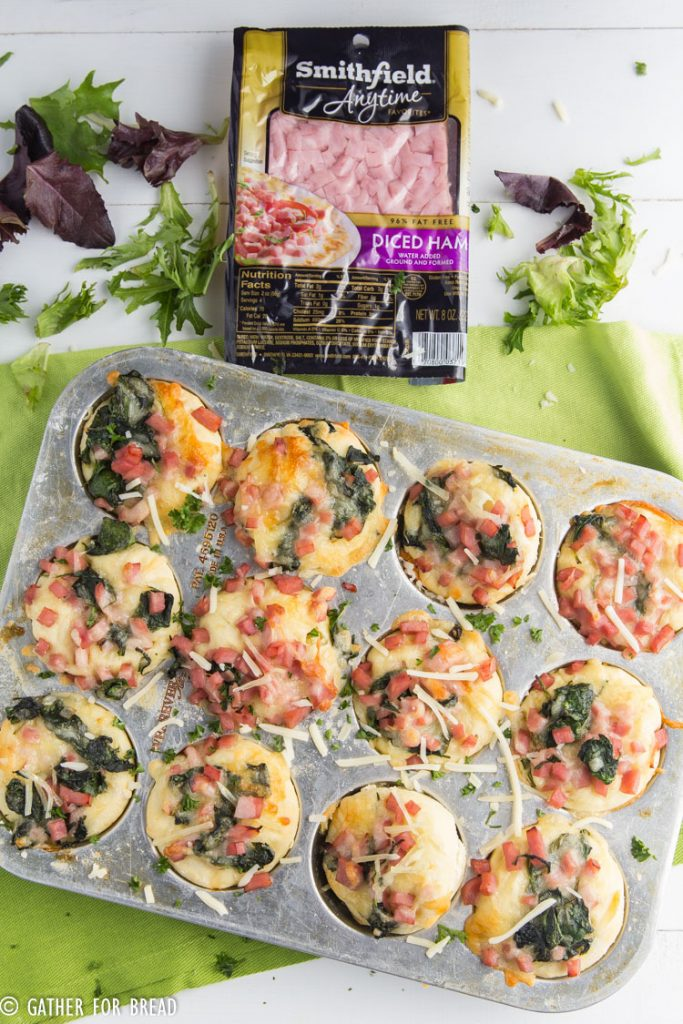 Ham Swiss Spinach Buns - Savory homemade dough wrapped up with diced ham, Swiss cheese and topped with spinach. These buns are perfect for breakfast, brunch or dinner and can easily be a grab and go hot meal.